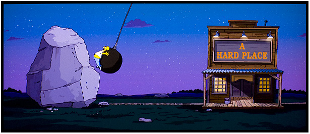 Simpson il film, Homer tra una roccia e a hard place